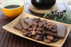 Cocoa bean and chocolate. I rode chocolate and cocoa bean on a plate Stock Photo