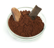 Cocoa bean, cocoa powder in bowls and piece of chocolate Stock Images