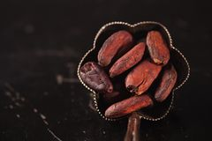 Cocoa beans on black stock photos