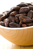 Cocoa beans in bowl Stock Photo