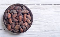 Cocoa beans in bowl Royalty Free Stock Image