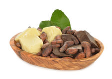 Cocoa beans, cocoa butter and cocoa mass. Isolated on white background Stock Images