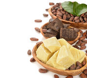 Cocoa beans, cocoa butter and cocoa mass. On a white background Royalty Free Stock Image