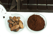 Cocoa beans, cocoa powder and chocolate bar Royalty Free Stock Photography