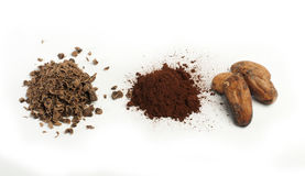 Cocoa beans, cocoa powder and grated chocolate Royalty Free Stock Photos