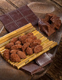 Cocoa beans, dark chocolate and chocolate truffles Royalty Free Stock Image