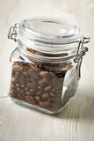 Cocoa beans in glass jar Royalty Free Stock Images