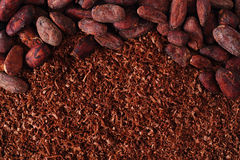 Cocoa beans and grated chocolate background Stock Images