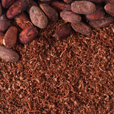 Cocoa beans and grated chocolate background Royalty Free Stock Photo