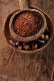 Cocoa beans and grated dark chocolate in old texured spoons bowl Royalty Free Stock Photo