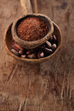 Cocoa beans and grated dark chocolate Stock Photo