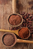 Cocoa beans, hot chocolate flakes and grated dark chocolate in o Royalty Free Stock Image
