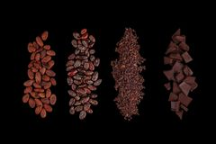 Peeled, chopped cocoa beans and  pile chopped, milled chocolate isolated on black background stock image