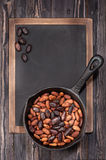 Cocoa beans in pan Royalty Free Stock Photography