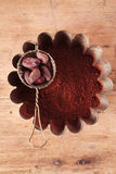 Cocoa beans in sieve with cocoa powder Stock Photo