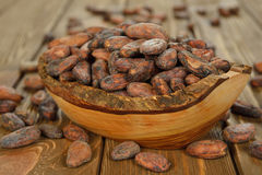 Cocoa beans in a wooden bowl Stock Image