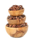 Cocoa beans in a wooden bowl Royalty Free Stock Images