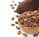 Cocoa beans in a wooden bowl Stock Photography