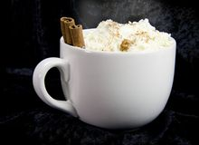 Cocoa on black. A steaming hot cup of cocoa on black background Stock Photo