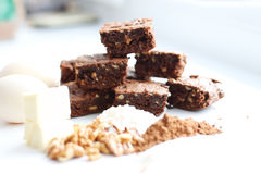 Cocoa brownies and ingredients Royalty Free Stock Photos