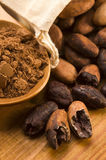 Cocoa (cacao) beans on natural wooden table Stock Photos