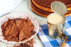 Cocoa and cakes. Different ingredients for chocolate cake Royalty Free Stock Images