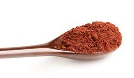 Cocoa in a ceramic spoon. Stock Photo
