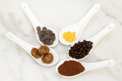Cocoa, chocolate praline, marron glacee, cacao and golden edible Stock Images