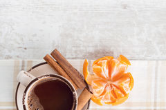 Cocoa with cinnamon and tangerine. White wooden background Stock Photos