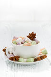 Cocoa with colorful marshmallows and Christmas cookies on white Royalty Free Stock Photo