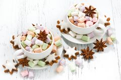 Cocoa with colorful marshmallows in cups and Christmas cookies Royalty Free Stock Photography