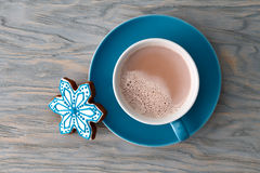 Cocoa cup with gingerbread snowflake candy stock photo
