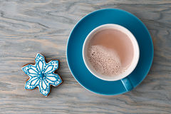 Cocoa cup with gingerbread snowflake candy royalty free stock images