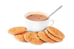 Cocoa in a cup and oatmeal cookies isolated on a white Stock Images