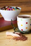 Cocoa drink and bowl with sweets royalty free stock photo