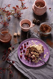 Cocoa drink with cinnamon, cranberry cake, cocoa powder, wooden background, overhead top view. Stock Images