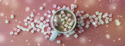 Cocoa drink with marshmallows isolated on pink or coral background, top view. Christmas hot drink. Banner. Cocoa drink with marshmallows isolated on pink or stock illustration