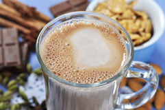 Cocoa in a glass cup. Closeup with chocolate and spices Stock Image