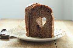 Cocoa Heart shaped  bread. Handmade Cocoa Heart shaped  bread Royalty Free Stock Images