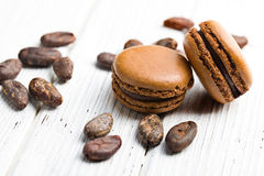 Cocoa macaroons with cocoa beans Stock Photos