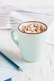 Cocoa with marshmallow in light blue cup on white background Stock Images