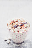 Cocoa with marshmallow topped with lavender and cinnamon powder Stock Photo
