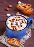 Cocoa with marshmallows and chocolate. Cocoa in blue mug with marshmallows and chocolate Stock Photo