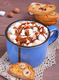 Cocoa with marshmallows and chocolate. Cocoa in blue mug with marshmallows and chocolate Royalty Free Stock Photo
