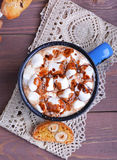 Cocoa with marshmallows and chocolate. Cocoa in blue mug with marshmallows and chocolate Royalty Free Stock Photos