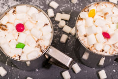 Cocoa with marshmallows and multicolored sugar candies on gray concrete background top view toned selective focus Royalty Free Stock Photo