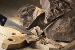 Cocoa mass and knife Royalty Free Stock Photo
