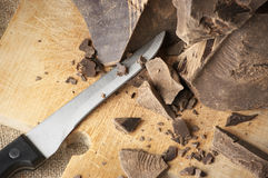 Cocoa mass and knife Stock Photos