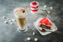Cocoa milkshake drink and desserts. Milkshakes and sweet cake. royalty free stock photography