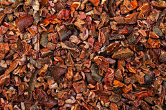 Cocoa nibs background. Bunch of raw organic crushed cocoa nibs stock photos